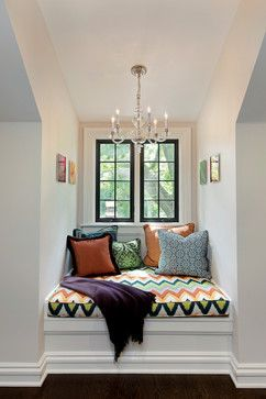Love the colors used in this cozy space! Love the chandelier in the nook!