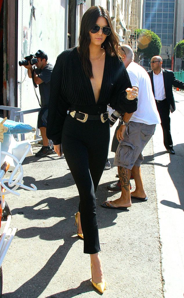 Daring Décolletage from Kendall Jenner's Street Style  Wearing her favorite B-Low the Belt waist-cincher, Kendall wears a risqué Esosa top with tight black jeans.