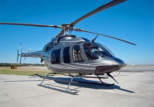 Bell 407 Helicopter - carries 6 passengers with pilot and co-pilot.