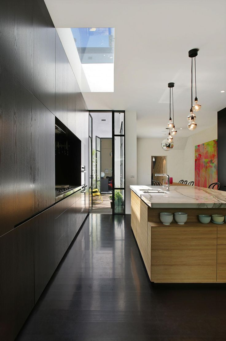 A renovation project by Carr Design Group. This features the kitchen. Photography by Michael Gazzola.
