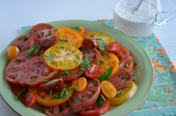 Heirloom Tomato Salad with Homemade Buttermilk Dressing  _ Fresh herb leaves and cracked black pepper for garnish. Serve buttermilk dressing over sliced tomatoes!