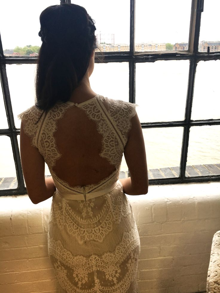 Andrea looks out over the River Thames from the Catherine Deane HQ in the Suri dress.