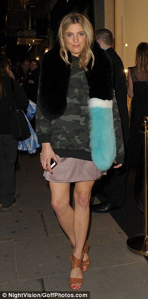 Twice as nice: Fashion blogger Olivia Cox donned a camouflage jumper and tan heels...