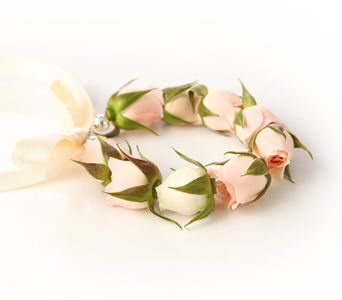 """BFP-R1a  """"THE Hot Look"""" in Prom fashions, our Rosebud Bracelet features a delicate array of fresh Spray Roses. Available in creamy ivory roses only.    Your choice of satin ribbon finishes the bracelet as it ties around your wrist. Personalize with a keepsake charm (purchased separately).    Priced at $37.95 (not including charm). Call or come by our shop today to select ribbon and place your order! Photo by Uchida Photography"""