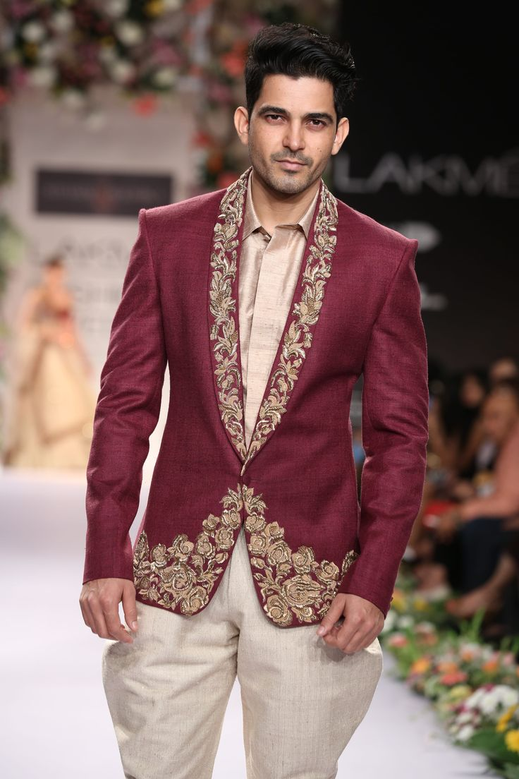 A maroon silk blazer with ornamented lapels and hem, team this with breaches and attend any wedding function!