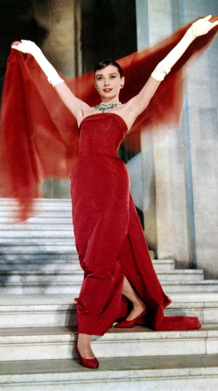 "LADY IN RED, Audrey Hepburn in ""Funny Face"" in a scarlett dress, designed by Givenchy. Taken in the Louvre, Paris one of the greatest scenes in movies.:"