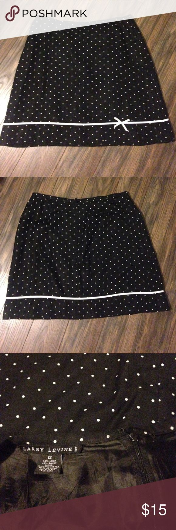 Larry Levine black and white polka dot skirt w/bow 19 inches in length,zip up back, fully lined in black. The little hook at the top of the zipper came off but other than that great condition. I love this skirt, it just doesn't fit anymore Larry Levine Skirts Mini