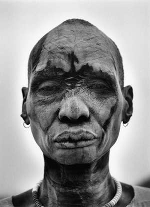 Sebastiao Salgado: Dinka man, skin covered with ash from cowpats, to protect against insects