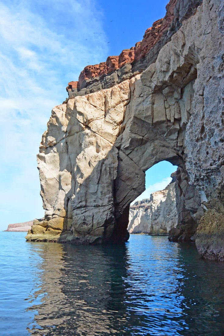 Isla Espiritu Santo - La Paz Mexico -- an island in the Gulf of California, off the Mexican state of Baja California Sur. --------------  Boat tour from La Paz to Espiritu island will take you past this beautiful arch. Plus you can swim with sea lions for about 800 MXN. Definitely worth the money for this day trip