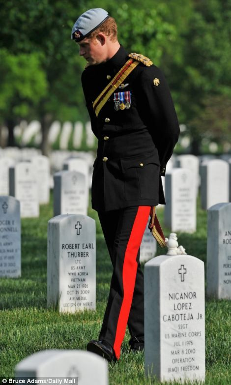 Prince Harry meets fellow soldiers wounded in war after paying tribute to the nation's fallen at Arlington Cemetery.