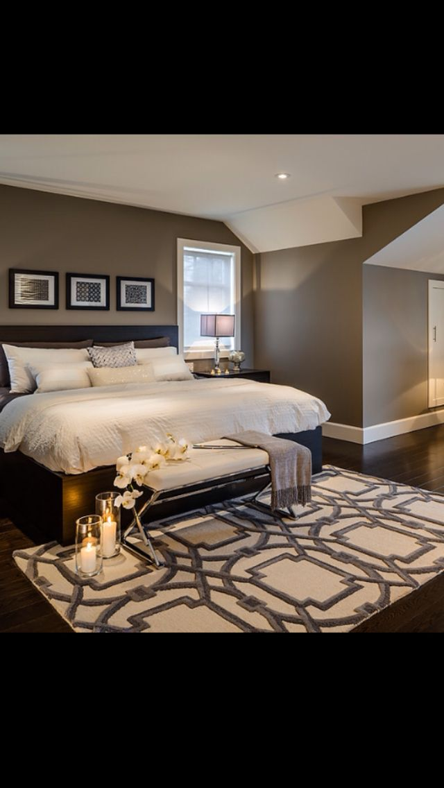 Love the wall color with black bed and off white bedding