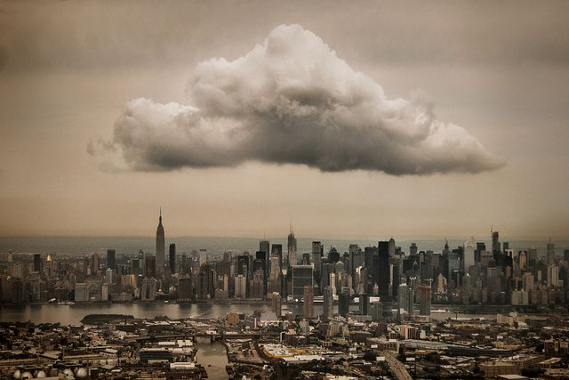 Midtown Cloud - I snapped this from the window seat as my plane was approaching LaGuardia Airport. The cloud is over Manhattan, while Brooklyn and Queens are visibile in the foreground, separated by Newtown Creek. By Jeff Weston  Jeff Weston, taken on September 6, 2012. via Flickr