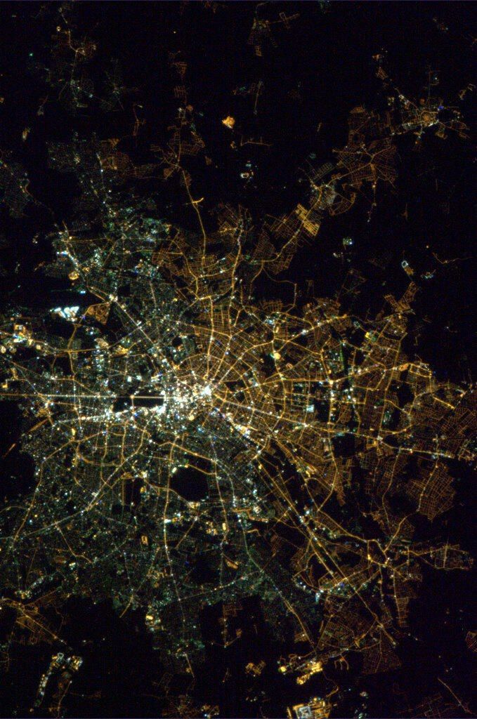 || East Berlin and West Berlin use different types of street lights, visible from space