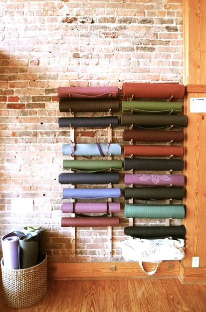 Yoga room - minimalist design where accessories are embraced as part of the decor and celebrated. Storage idea for new studio and you could do it with foam rollers too