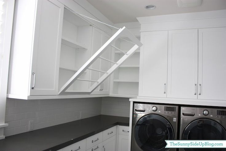 Like the pull down laundry hanger Sunny Side Up - laundry/mud rooms - laundry room, white and grey laundry room, shaker cabinets, white shaker cabinets