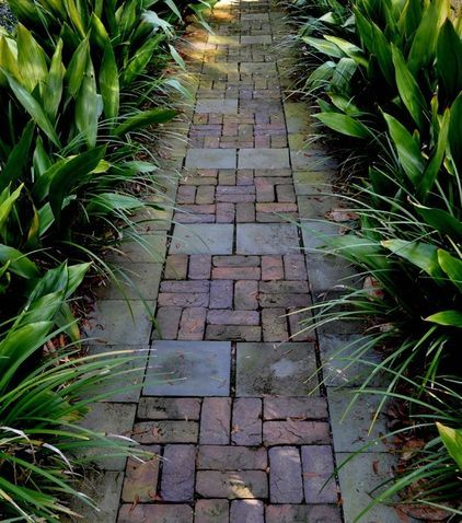 Combining materials creates the feel of a walkway that has always been there. This mixture of slate and brick looks well worn and aged.