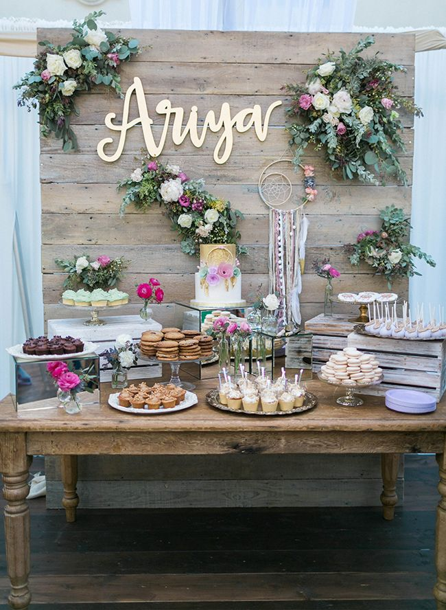 This whimsical feminine baby shower couldn't be prettier. From the ethereally draped tent to the incredible dessert display, this mama-to-be was showered in style.