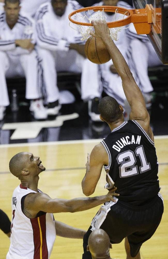 San Antonio Spurs power forward Tim Duncan (21) dunks on the Miami Heat during the first half of Game 6 of the NBA Finals basketball game, Tuesday, June 18, 2013 in Miami