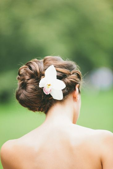 wedding hair- I love the orchid in her hair... I wonder how long it would last like that...