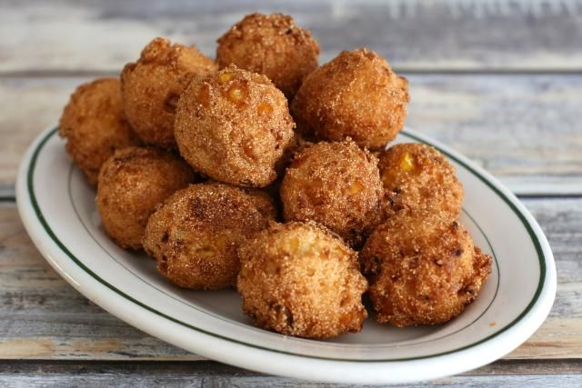 Recipe for Hush Puppies with cream style corn, chopped onion, and cornmeal. These hush puppies are deep fried.