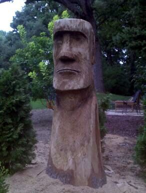 Tree trunk carved into an Easter Island head