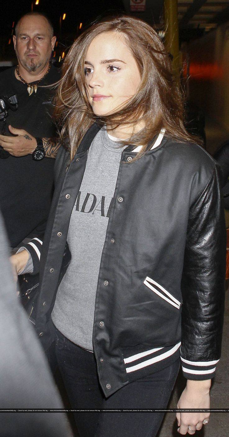 Emma Watson jetted in to LAX sporting a black and white jacket, black jeans and…