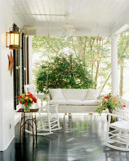 Gorgeous Porch! Wood floors, cushy swing, love the colors and the ceiling fan!