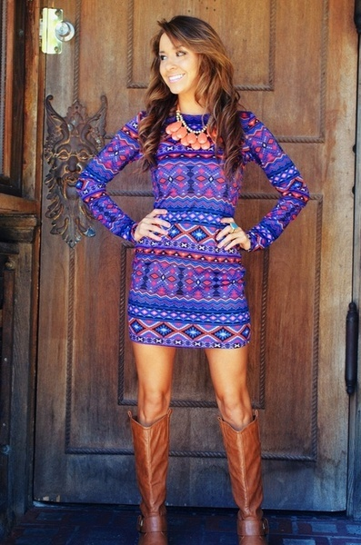 Southern Sweetie. Brown knee high boots. Aztec blue & orange tight long sleeved dress. Orange & gold necklace.