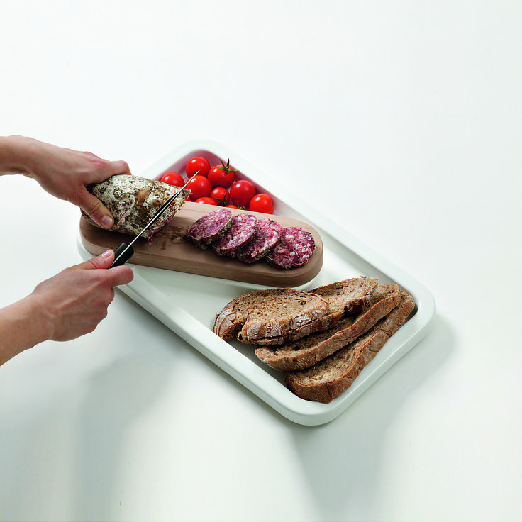 """Elegant kitchen utensil dedicate to the """"bread and salami"""", one for the most common and appreciated italian dishes. The combination of ceramic tray and wooden cutting board makes this object practical and elegant. available only on http://www.bosatrade.com/en/Products#filter=*"""