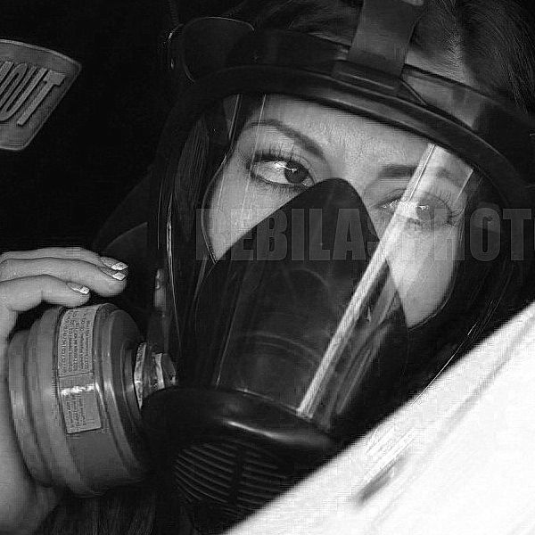 Leah Pritchett wears a Gasmask as she warms up her powerful Dragster