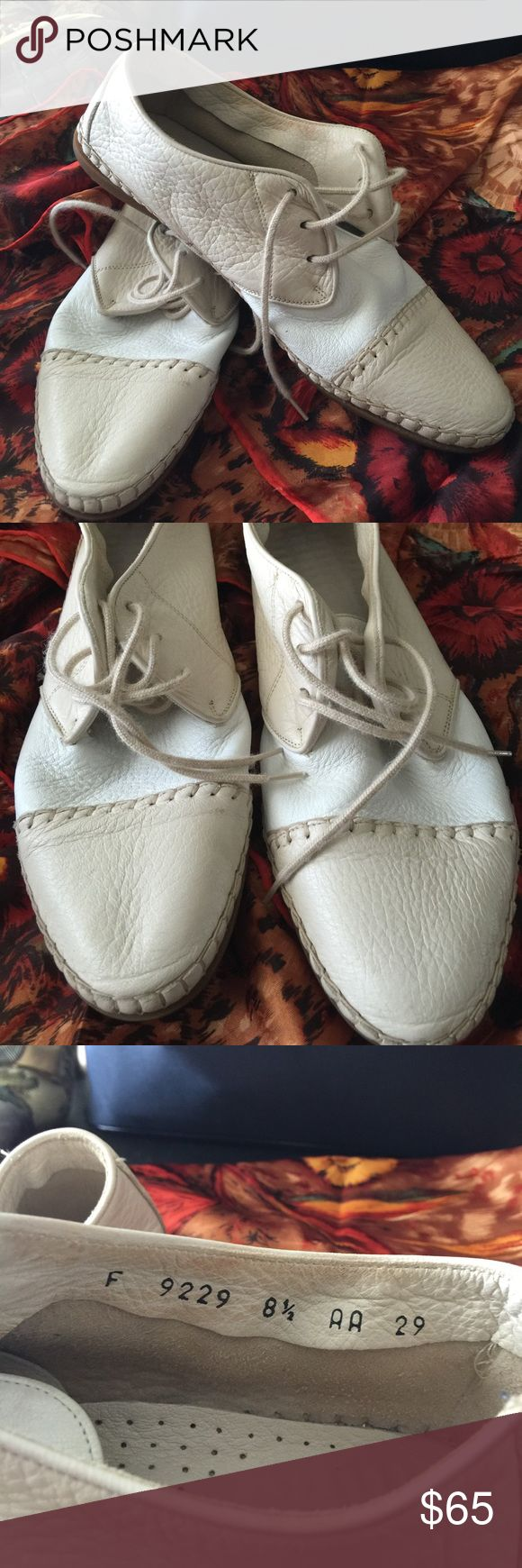 Must have adorable Cole Haan oxfords These yummy shoes are like being barefoot. The leather is so buttery soft. They are two tone white and soft putty/tan in color. The size is marked 8.5 AA. I believe they run substantially small though. I wear a 6.5 and i could wear them but probably best for a 7. Made in Italy. Cole Haan Shoes
