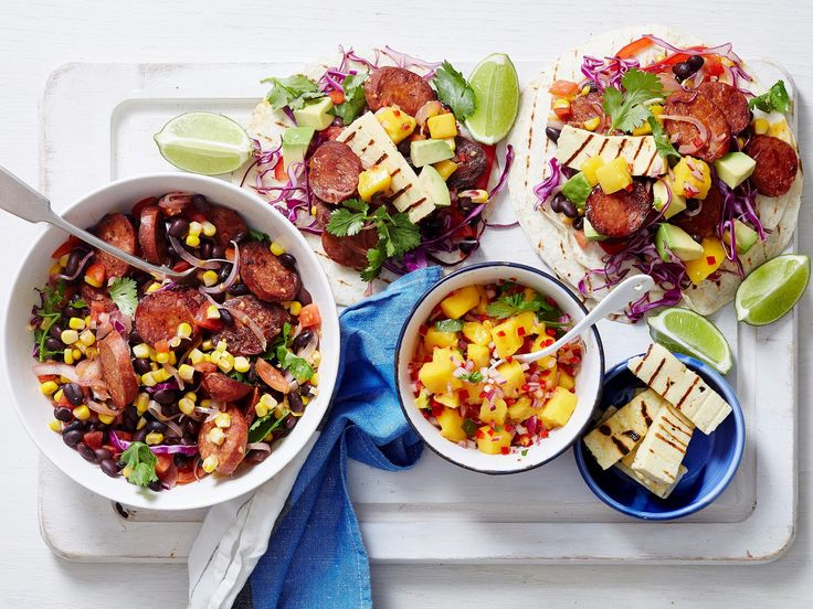 Tasty tortillas are packed with smoked chorizo, grilled haloumi and a homemade mango and avocado salsa in this recipe, making for a gorgeously colourful and delicious dinner the family will love.