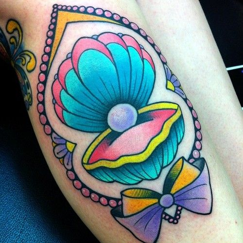 tattoos of clams, pearls mermaids colorful tatt pink purple yellow green