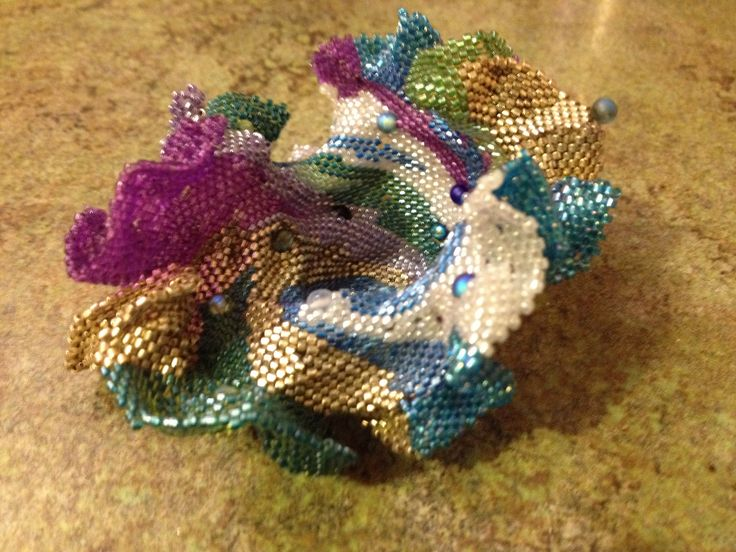 Free form peyote stitch with Delica beads.