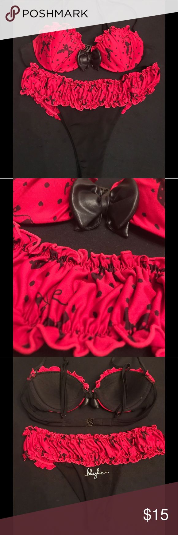Blue Glue Adorable Red & Black Bikini How freaking cute is this?!?!? Red and black polka dots with little bows adorn this ruffled, girlie, sea-side Oh My Goodness bikini.  Ruffled bottoms are Uber-comfy and will show off your tushy and flatter your bottom!  Top is scalloped and padded with adjustable straps and cute little ruffles along your ta-tas.  You must! Blue Glue Swim Bikinis