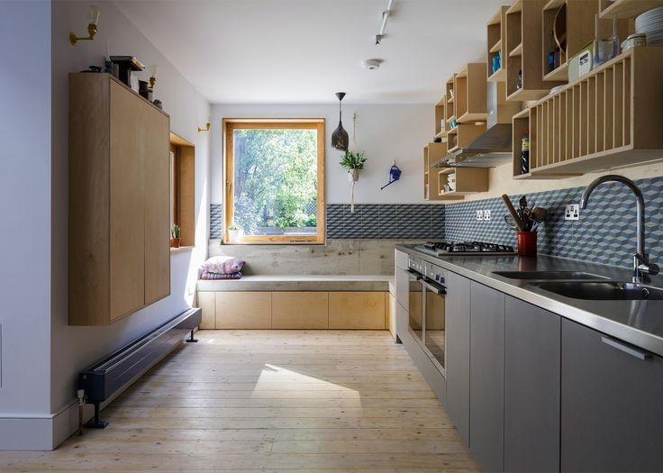 """<a href=""""http://www.dezeen.com/2015/12/22/mustard-architects-nook-house-renovation-extension-east-london-corners-crevices/"""">A concrete window seat and a storage wall made of wooden boxes feature inside this Nook House by Mustard Architects"""