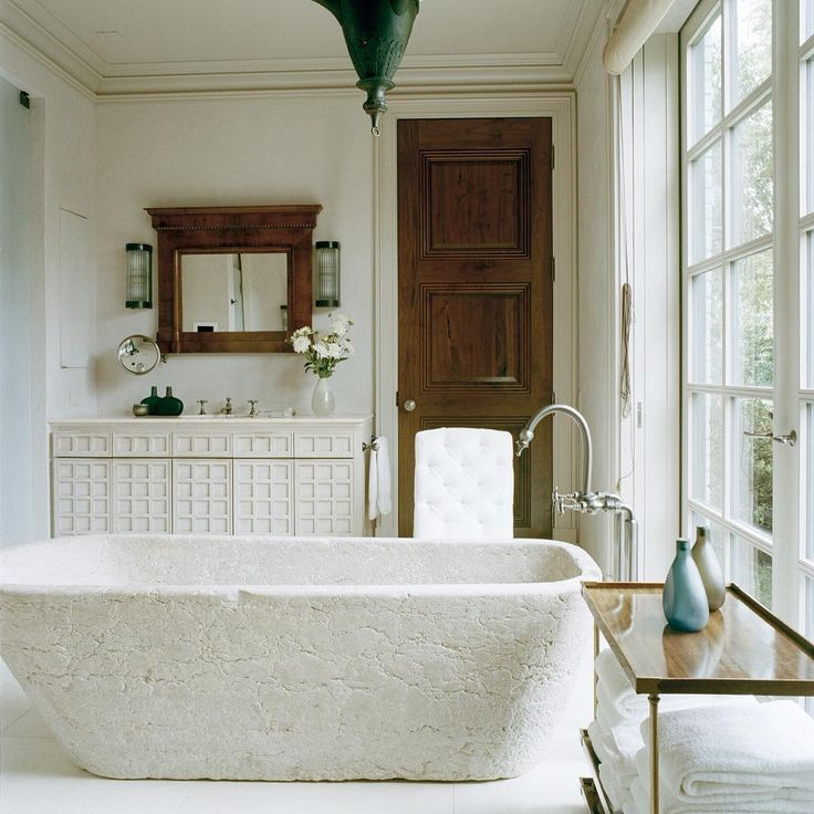 Photo Album For Website freestanding stone tub in neutral bathroom note the brass shelf for towel storage