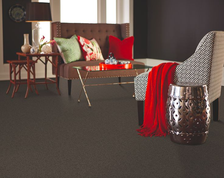 Red and green aren't just for the holidays! Add the two colors to an all-black room for a playful, summer-inspired decor theme.