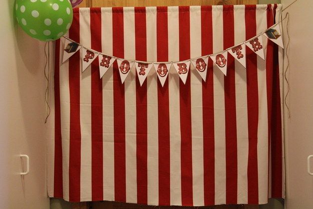 Create a photo booth with a circus tent backdrop. | 17 Things For An American Horror Story Freak Show Halloween Party