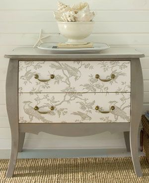 Transform a dresser with paint and wallpaper. Chic taupe paint and toile wallpaper highlight this dresser's traditional lines. Play with the position of the wallpaper until you're happy with the design, and then cut the paper to fit the drawer fronts. After painting the dresser, apply the wallpaper; protect it and the painted surfaces with an acrylic sealer.