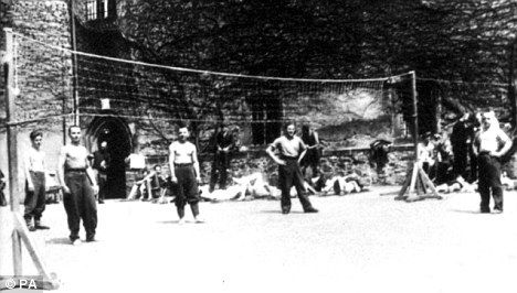 Escapades: Prisoners play volley ball inside Colditz Castle. It was where the Nazis sent PoWs who had fled from other camps