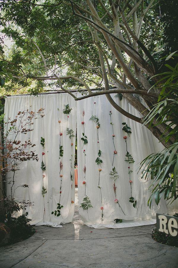 great way to spruce up curtains for a ceremony backdrop! photo by Wild Whim Photography http://ruffledblog.com/camarillo-botanical-wedding #backdrops #weddingideas #flowers