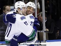 manny malhotra and Ryan kesler- Vancouver Canucks