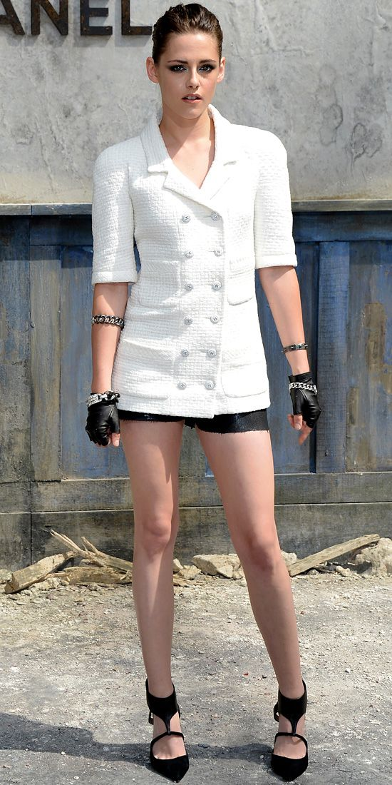KRISTEN STEWART At the Chanel couture show in Paris, Kristen Stewart gave the label's iconic tweed jacket her own spin, teaming it with black short shorts, black moto gloves, black strappy Jean-Michel Cazabat heels and strategically placed gunmetal bangles.