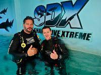 True Blood star Joe Manganiello and Shark Dive Xtreme instructor Tom.