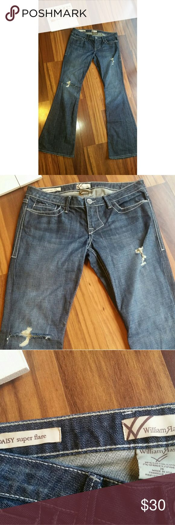 William Rast Super Flare Jeans Sz 29 Distressed William Rast Jeans size 29 *Daisy Super Flare Low Rise  *Distressed, destroyed look *Dark Denim *Waist: 17   inches (lying flat aligned edge to edge) *Front Rise: 8  inches *Inseam: 35 inches  There is distressing by manufacturer and even wear and tear on some of the pockets and the bottom hem (as shown in pic). This could be manufacturer design. William Rast Jeans Flare & Wide Leg