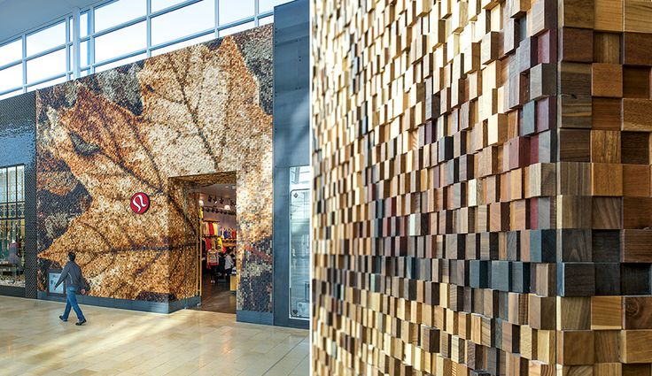 Holy cow! Custom mosaic wood wall tile made from unstained hardwood off-cuts.  Lululemon Athletica store, Toronto.