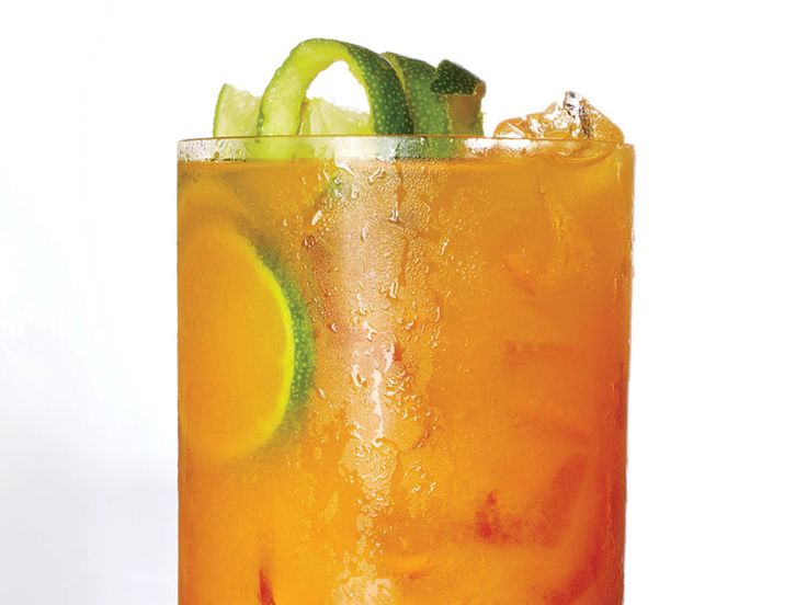 This is a turmeric-laced twist on a Dark and Stormy, the classic dark rum and ginger beer combo. Turmeric abounds with natural medicinal properties. Some studies have found that it may help prevent indigestion, blood clots, and possibly even diseases like Alzheimer's and Parkinson's. If you don't have fresh turmeric, substitute 1 teaspoon ground turmeric.