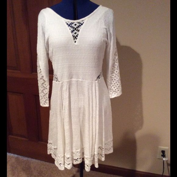 """FREE PEOPLE WHITE DRESS HP 10/8  NWT This NWT WHITE DRESS IS UNIQUE WITH CUTOUTS THROUGHOUT. DRESS IS LINED AS WELL  EXTREMELY SOFT AND """"STRETCHY""""   Length from shoulder to hem is 36"""". Great dress by Free People Free People Dresses"""