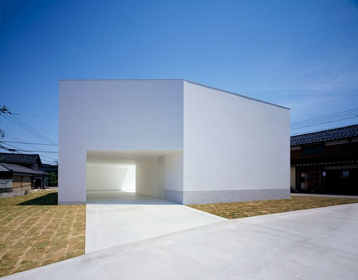 White Cave House is a massive lump engraved by a series of voids interconnected in the shape of a kinked tube. The connection of voids - we call it Cave - is the theme of this house. Internal rooms are designed to enjoy the minimum views of Cave character